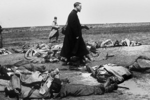 French chaplain walks amongst the recent dead