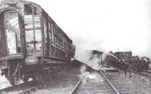 The skeletal burnt-out remnants of the troop train still smouldering hours after the crash