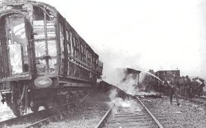 The skeletal burnt-out remnants of the troop train still smouldering hours after the crash