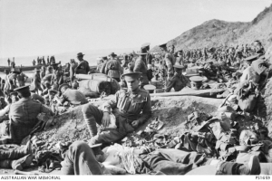 Wounded Anzacs lying under cloudless sky