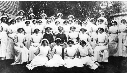 Edith Cavell surrounded by her staff and nursing students at the Berkendael Institute, Brussels.