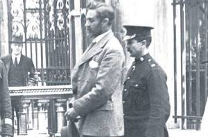 Roger Casement escorted by police during his trial.