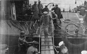 Lord Kitchener transferring to Jellicoe's flagship HMS Iron Duke before attic sail on the Hampshire on 5 June 1916.