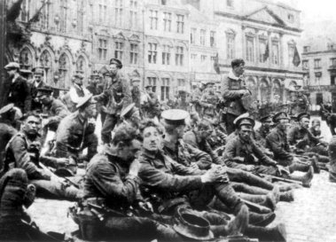 Ypres 1914. BEF soldiers resting before the Battle of Mons in front of the Cloth Hall.