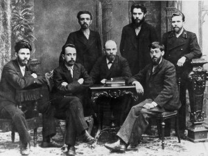 Friends together before the 1903 split. Trotsky seated left, Lenin seated centre and Martov seated to the right.