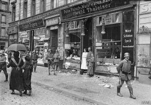 Reality in the streets of a famished Germany, where food shops had to be guarded by the military.