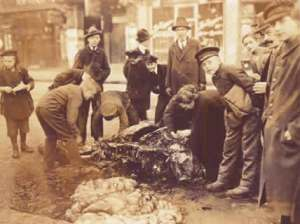 The carcass of a horse which had been cut apart in the street to feed the local people.